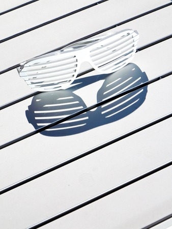 glases: shadows of sunglasses because of sun Stock Photo