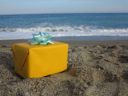 a little yellow present on the beach photo