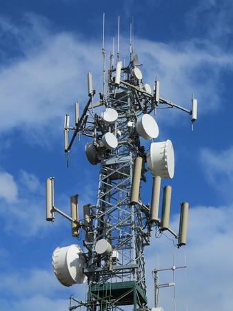 satelite: satelite tower with a blue sky