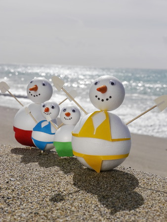snowman beach vacation holidays from cold winter photo