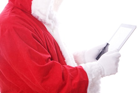 santa claus with digital tablet. isolated on the white background photo