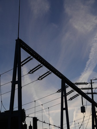 Electrical power grid in silhouette photo
