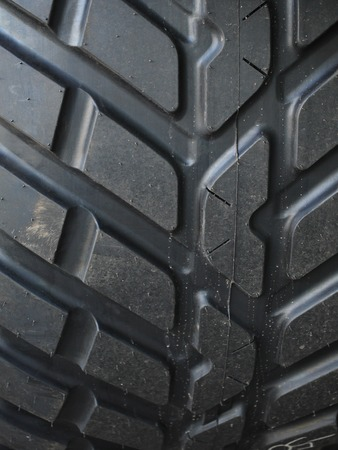 unevenness: the pattern of a big black tire
