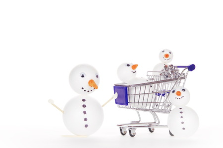 snowman shopping cart isolated on white background photo