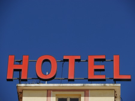 Neon Sign with the word Hotel photo