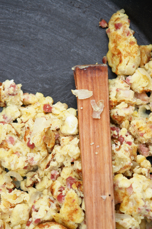 pan full of scramled eggs with spoon in pan yellow photo