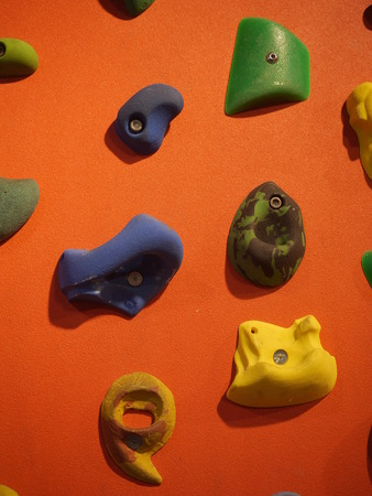 climbing  wall: a climbing wall with hanger to hold