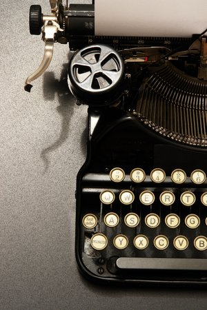 a typewriter in dramatic lighting.