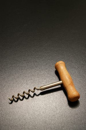 a corkscrew in dramatic lighting. photo