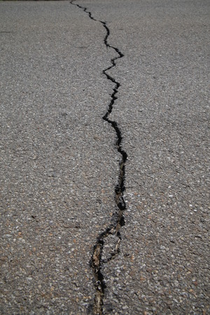 texture of tarmac road with cracks - abstract  photo