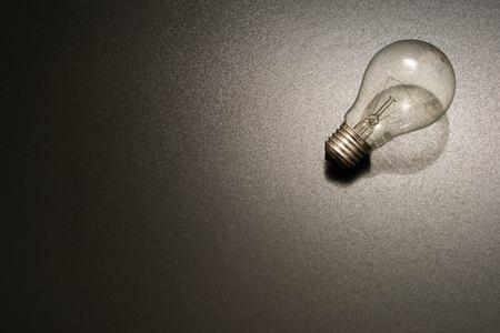 a light bulb in dramatic lighting. photo