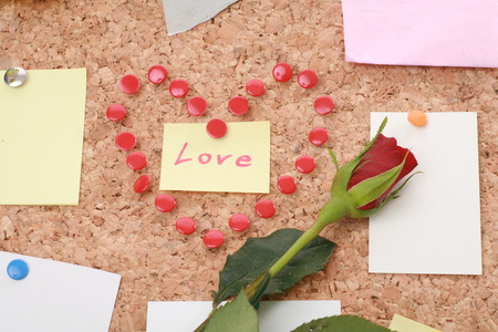 loves: a valentine heart made of thumb tacks on a corkboard Stock Photo