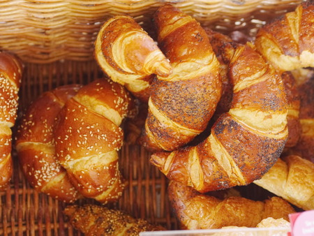 Fresh baked croissants in the basket. photo