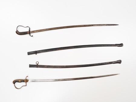 sabel: Old saber isolated on white