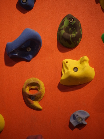 a climbing wall with hanger to hold
