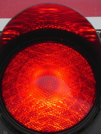 cross street with care: a traffic light shows red light. symbolic photo for maintenance, exit and risk. Stock Photo