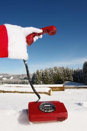 Santa Claus Hotline symbolized by a red retro phone photo