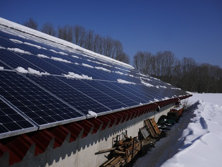 producing: solar cell on on roof producing electricity