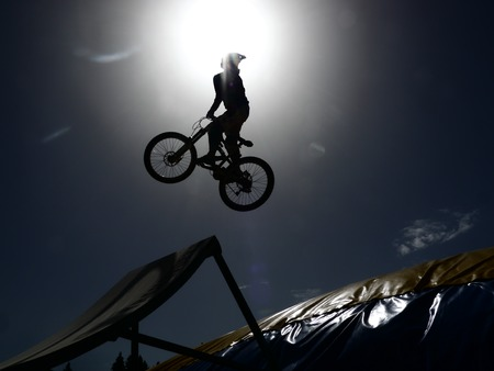 rider jumping with it dirtbike photo