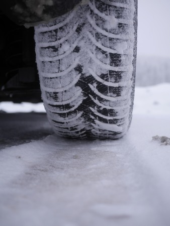 tires which leave tiretracks in the snow Stok Fotoğraf