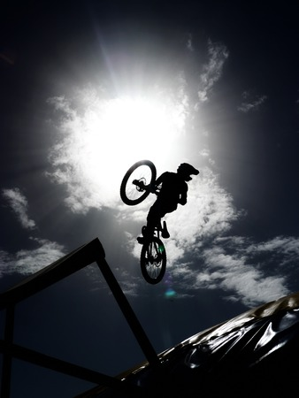 extreme danger: rider jumping with it dirtbike