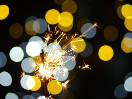 sparklers on new years eve with bokeh background photo