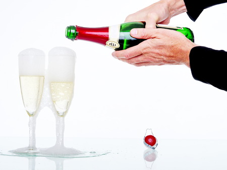 Champagne pouring in two glasses photo