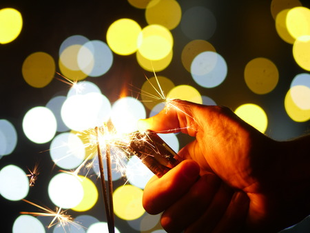 sparklers on new year's eve with bokeh background photo