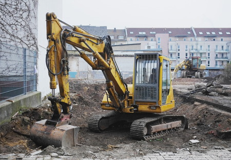 front end loader: Excavator or digger on an urban building site being used for earthworks and clearing the site for construction