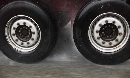 hydroplaning: Fast truck wheels on the road hydroplaning