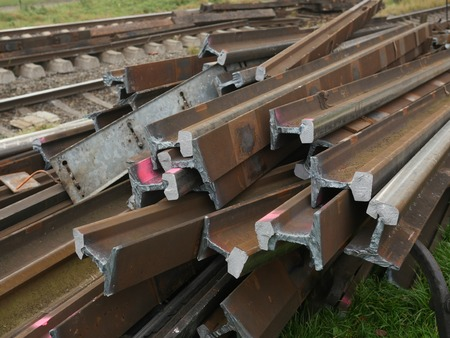 unnecessary: Depo with stack of old rusty rails Stock Photo