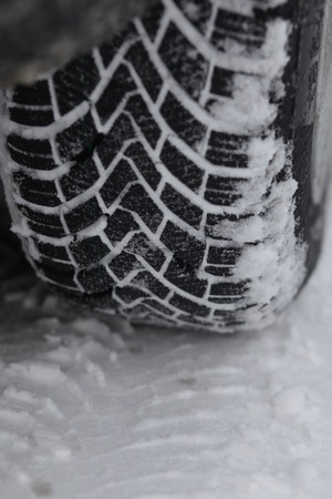 tyre tread: Close up view of the tread on a winter tyre on snow