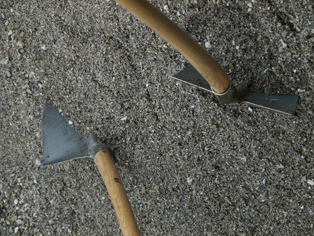 shovel in dirt: Closeup of a shovel digging into pile of building sand
