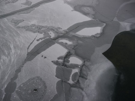 interstice: Ice surface on a lake