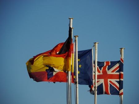 coalition: three flags are flowing in the wind Stock Photo