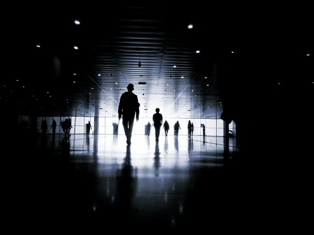 business people walking: Three business people walking down the street talking. Silhouettes.