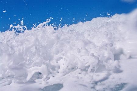 shorebreak: Blue Ocean Wave landing on the coast