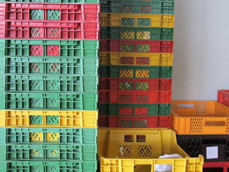 viewable: Colour plastic boxes out side Stock Photo