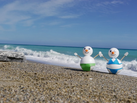 winter vacation: snowman beach vacation holidays from cold winter Stock Photo