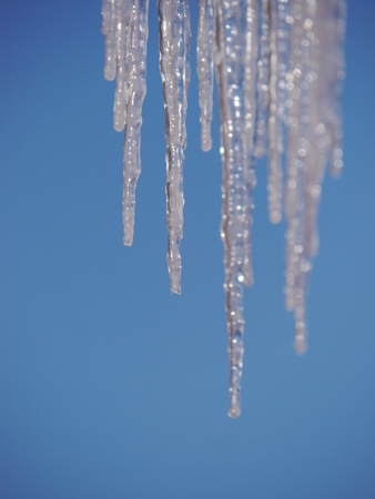 squall: icicles hanging from the roof outside in landscape
