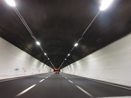 dui: tunnel car motion blur night traffic fast