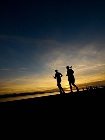 jogger: silhouette of a jogger in sunrise