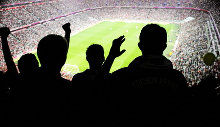 fan: Silhouettes of fans celebrating a goal on football match