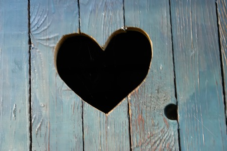 privy: heart shape cut into wooden door as the concept of love
