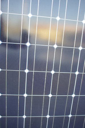 voltaic: solar cell on on roof producing electricity