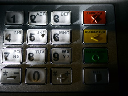 automatic teller: Finger using automatic teller keypad to enter pin number Stock Photo