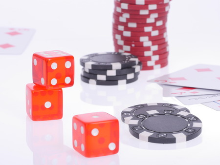 disordered: cards, dice and chips for poker, disordered Stock Photo