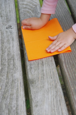 a child is folding a paper ship