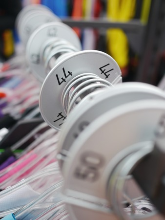 checkroom: hallstand with many clothes in different dress sizes Stock Photo