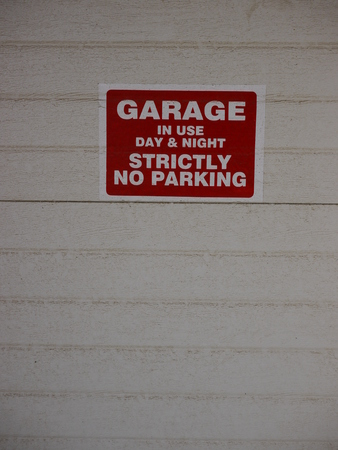 strictly: a red sign with white letters which shows strictly no parking